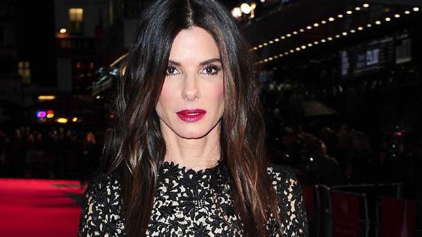 Sandra Bullock is considering a role portraying the creator of the Tupperware party