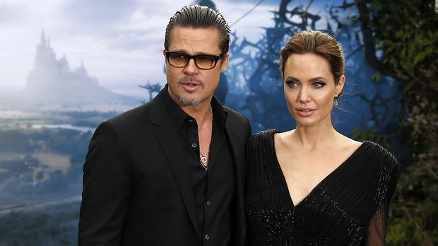 Brad Pitt and Angelina Jolie attend the Maleficent event in London