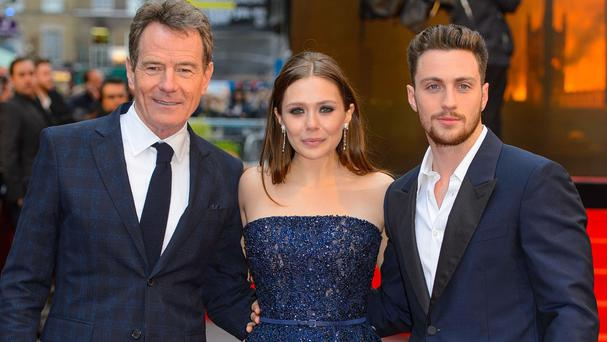 Bryan Cranston, Elizabeth Olsen and Aaron Taylor-Johnson at the European premiere of Godzilla in London