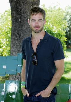 COOL HANDS: Chris Pine has every reason to look contented with life, not only is he a darling of Hollywood, but he is also Armani's new 'Code Man' and classically good looking too