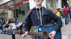Elliott Nolan (14), from Newbridge, Co Kildare, performs as he waits to audition for the film 'Sing Street' in Dublin's Temple Bar. Photo: El Keegan