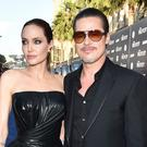 Brad Pitt and partner Angelina Jolie at the Maleficent premiere (Invision/AP)