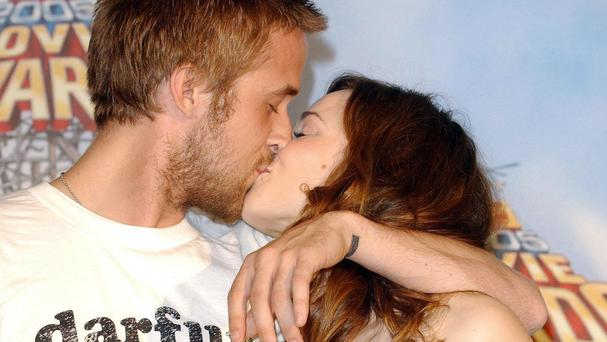 Ryan Gosling and Rachel McAdams celebrate winning the MTV Movie award for Best Kiss for The Notebook in 2005