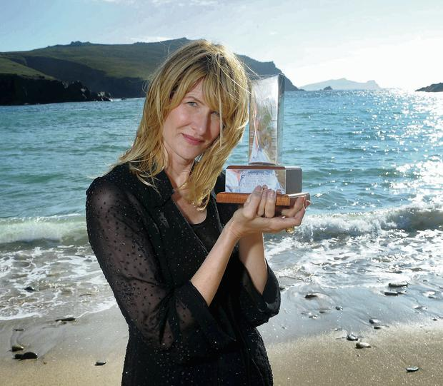 Laura Dern at Clogher Strand in west Kerry with her award from the Dingle International Film Festival. Photo: Don Macmonagle