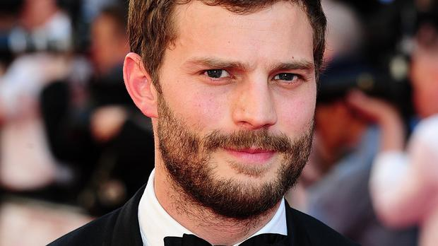 Jamie Dornan plays hunky billionaire Christian Grey in the Fifty Shades Of Grey film