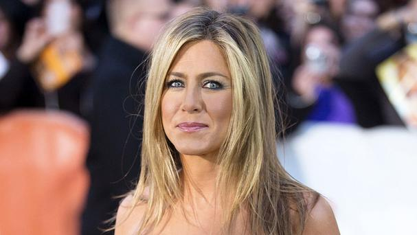 Jennifer Aniston has talked through her 70s look for Life Of Crime