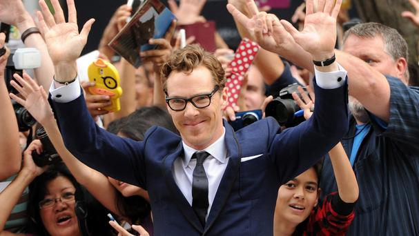 Benedict Cumberbatch greets fans at the premiere of The Imitation Game at the Toronto International Film Festival