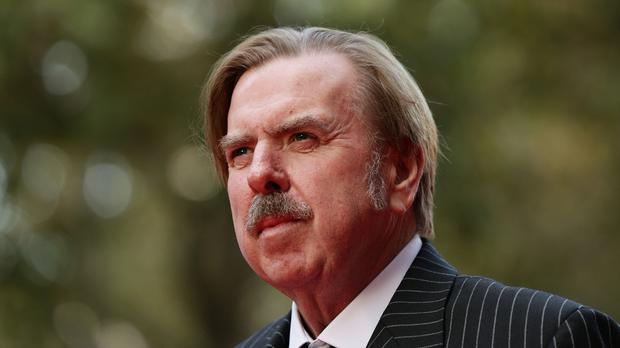Timothy Spall arriving at the BFI London film festival gala of Mr Turner at Odeon West End in Leicester Square, London
