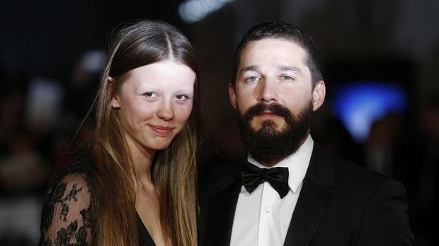 Shia LeBeouf and Mia Goth arrive for the BFI London Film Festival closing night gala screening of Fury at the Odeon, Leicester Square, London.