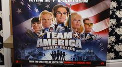Team America: World Police producer Matt Stone holds a poster of the 2004 hit comedy