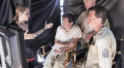 Angelina Jolie on the set of Unbroken with Jack O'Connell, Domhnall Gleeson and Finn Wittrock