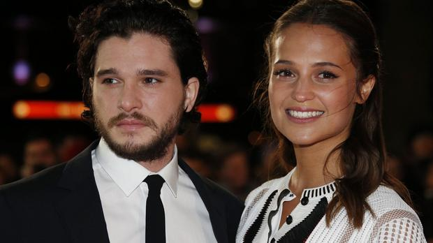 Alicia Vikander and Kit Harington attend the premiere of Testament of Youth at the Empire, Leicester Square, London.