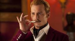 Johnny Depp stars in Mortdecai as an art dealer with a pristine moustache