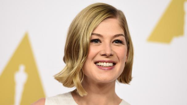 Rosamund Pike smiles as she arrives at the 87th Oscars lunch at the Beverly Hilton Hotel (AP)