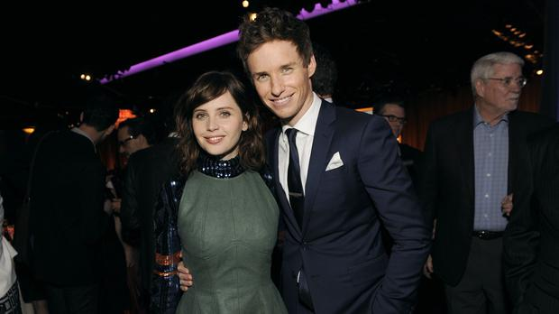 Felicity Jones and Eddie Redmayne were among the Oscar nominees at the annual Beverly Hills lunch (AP)