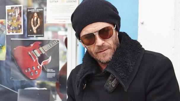 Luke Perry plays a former rock star with a debilitating injury in The Beat Beneath My Feet