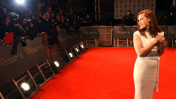 Amy Adams arrives for the Baftas at the Royal Opera House in London (AP)