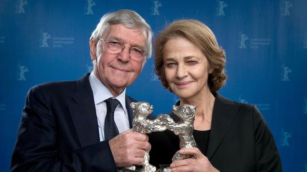 Tom Courtenay and Charlotte Rampling hold their Silver Bears for best actor and actress at the Berlin International Film Festival (AP)