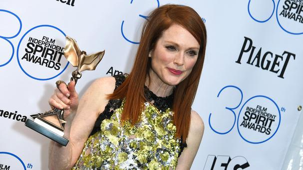 Julianne Moore poses with her award for best female lead for Still Alice (AP)
