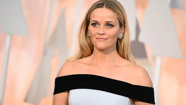 Reese Witherspoon wanted Hollywood's biggest stars to be asked about more than just their dresses, make-up and jewellery (AP)