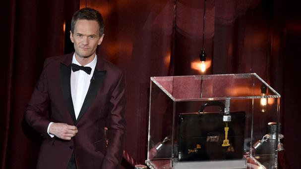 Host Neil Patrick Harris on stage at the Oscars (AP)
