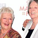 Dame Judi Dench and Dame Maggie Smith at the premiere of The Second Best Exotic Marigold Hotel in Leicester Square