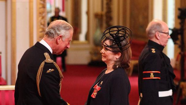 Actress Emily Watson is made an Officer of the Order of the British Empire (OBE) by the Prince of Wales at an Investiture ceremony at Buckingham Palace