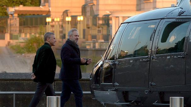 Director Sam Mendes, right, speaks to actor Christoph Waltz, left, during the filming of the new James Bond film, Spectre, in London