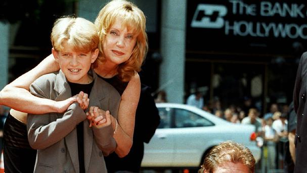 Mary Ellen Trainor and her son Alex outside Mann's Chinese Theatre in Hollywood. (AP)