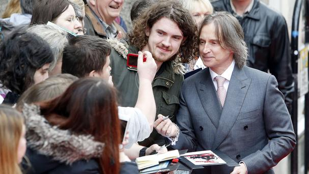 Robert Carlyle (right) arrives for the screening of The Legend of Barney Thomson on the opening night of the Edinburgh International Film Festival