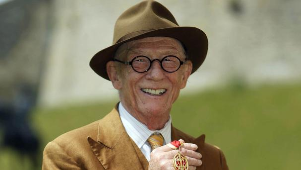 Sir John Hurt after being awarded a knighthood by the Queen at Windsor Castle