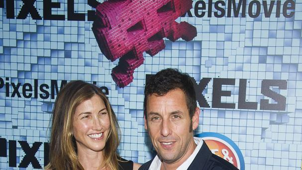 Adam Sandler and his wife Jackie at the world premiere of Pixels in New York (Invision/AP)