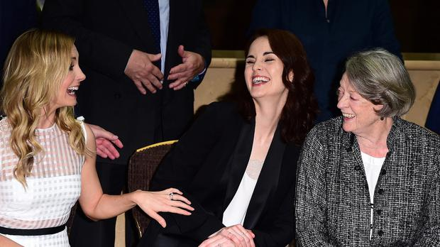 Joanne Froggatt jokes with Michelle Dockery as the cast of Downton Abbey, including Dame Maggie Smith mark the filming of the final episode