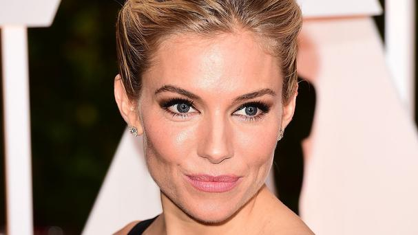 Sienna Miller stars alongside Charlie Hunnam in The Lost City Of Z