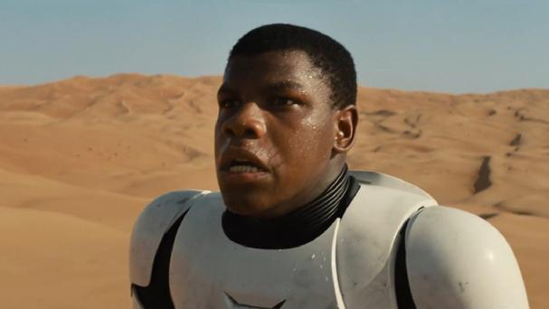 The latest trailer shows actor John Boyega (Finn) wielding a blue lightsaber.