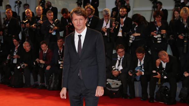 Tom Hooper said there was much more the film industry could do to improve opportunities for transgender actors (AP)