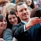 Michael Fassbender takes a photo with fans at the UK premiere of 'Macbeth' in Edinburgh