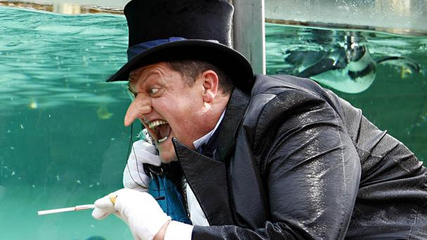 Actor Alex Giannini, pictured in character as The Penguin from the Batman live stage show at ZSL London Zoo's Penguin Beach attraction, has died aged 52