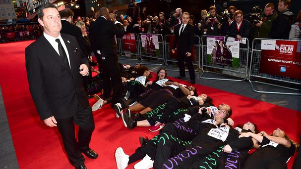 Protesters lie on the red carpet during the Suffragette premiere