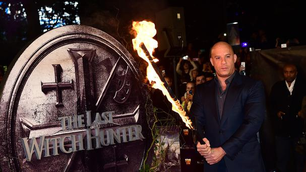 Vin Diesel holds a flaming sword as he attends The Last Witch Hunter premiere at Empire Leicester Square, London