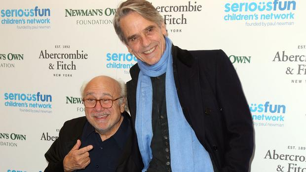 Danny DeVito (left) and Jeremy Irons arrive at the charity event