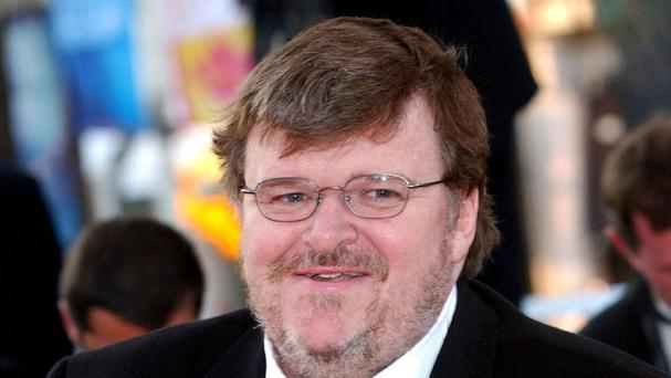 Film-maker Michael Moore says David Cameron and Tony Blair tried to emulate America