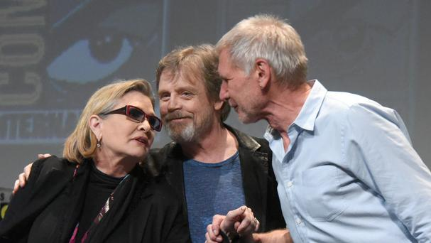 Carrie Fisher is returning to Star Wars with original co-stars Mark Hamill, and Harrison Ford (Richard Shotwell/Invision/AP)