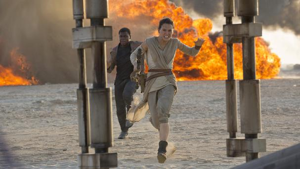 Daisy Ridley as Rey and John Boyega as Finn, in a scene from Star Wars Episode VII: The Force Awakens (Disney/Lucasfilm/AP)