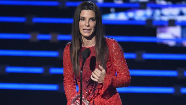 Sandra Bullock accepts the award for favourite movie actress for Our Brand Is Crisis at the People's Choice Awards in Los Angeles. (Chris Pizzello/Invision/AP)