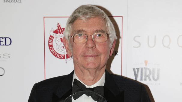 Tom Courtenay displays his award for Actor of the Year at the London Critics' Circle Film Awards