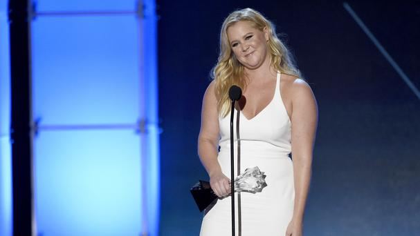 Amy Schumer accepts the Critics Choice MVP award. (Invision/AP)