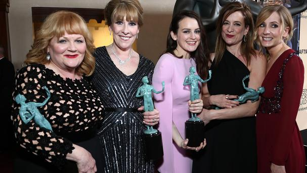 From left, Lesley Nicol, Phyllis Logan, Sophie McShera, Raquel Cassidy, and Joanne Froggatt celebrate the award for outstanding ensemble in a drama series for Downton Abbey (Invision/AP)