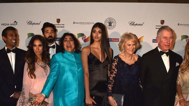 The Prince of Wales and the Duchess of Cornwall (centre right) with Neelam Gill (centre) attending a reception and dinner for supporters of the British Asian Trust at the Natural History Museum in London.