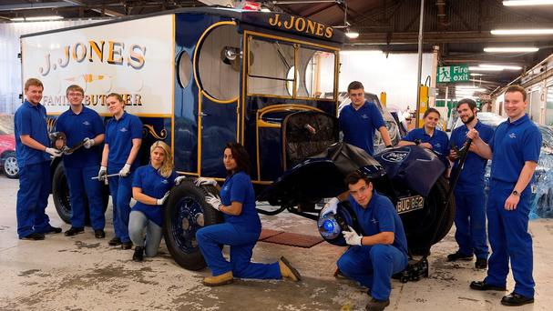 Ford apprentices working on the restored original butcher's van featured in the Dad's Army comedy series (Ford/PA)